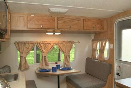Serro Scotty Sportsman Small Travel Trailer Interior   Front View Showing  Overhead Cabinets.