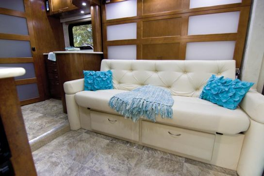2015-pleasure-way-plateau-xl-widebody-class-b-motorhome-couch