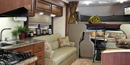 Interior of a Fleetwood Tioga Ranger 31N in Spiced Coffee interior decor with Toasted Chestnut wood cabinetry