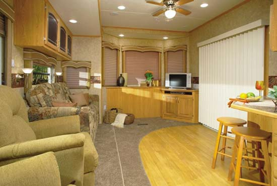 Crossroads Hampton destination trailer interior showing patio door and spacious living area