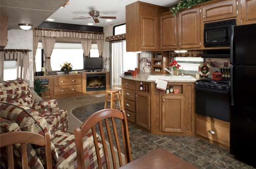 Keystone Residence destination trailer interior showing patio door and living area