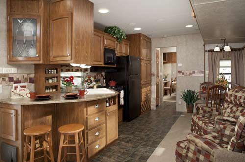 Keystone Residence destination trailer interior showing large windows and domestic style furniture
