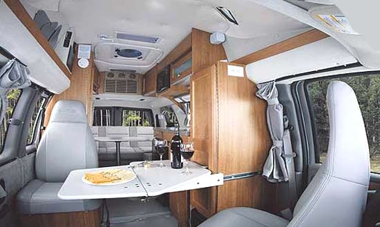 Roadtrek 170-Popular class B motorhome interior - seating and table arrangement