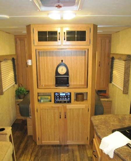 Skyline Koala travel trailer interior - bedroom and TV