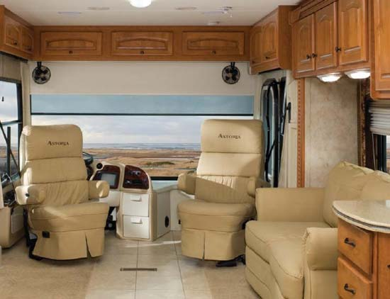 Damon Astoria class A motorhome interior showing front seats rotated as part of living area