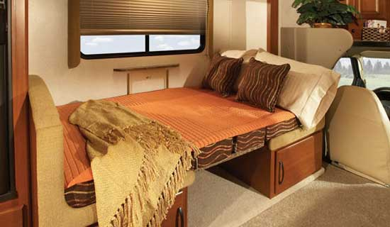 Fleetwood Jamboree class C motorhome interior - dinette converted to a bed