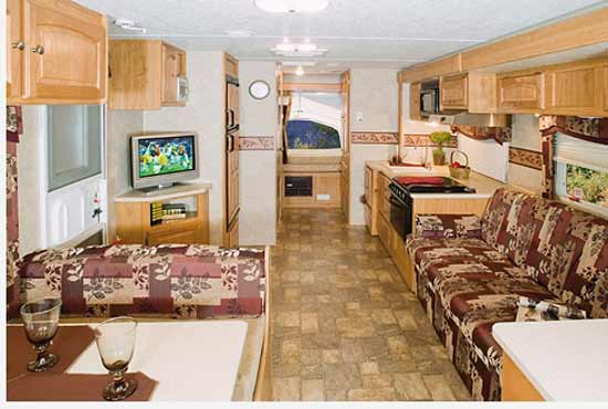 Palomino Stampede ultra-lite travel trailer interior - S-238 model looking to the rear