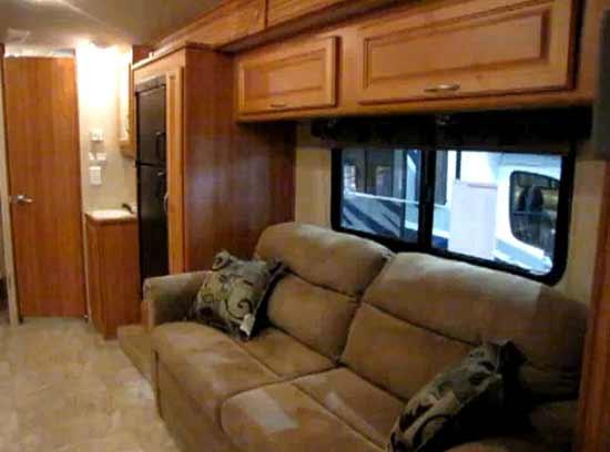 2010 Fleetwood Quest class C motorhome interior showing living area