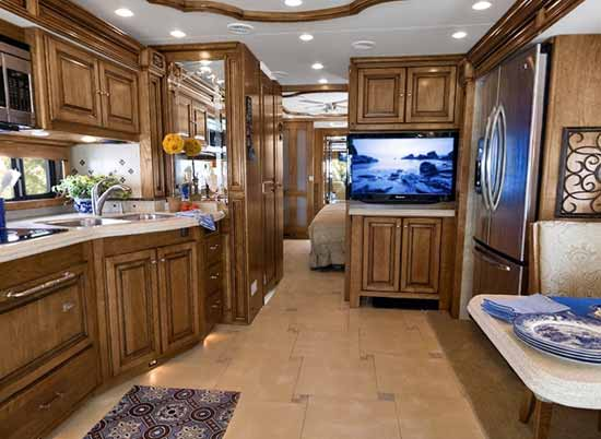 Tiffin Alllegro Bus interior showing kitchen, living area and part of bedroom area
