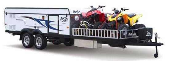 Jayco Baja camping trailer in travel mode with toys loaded on bike port deck