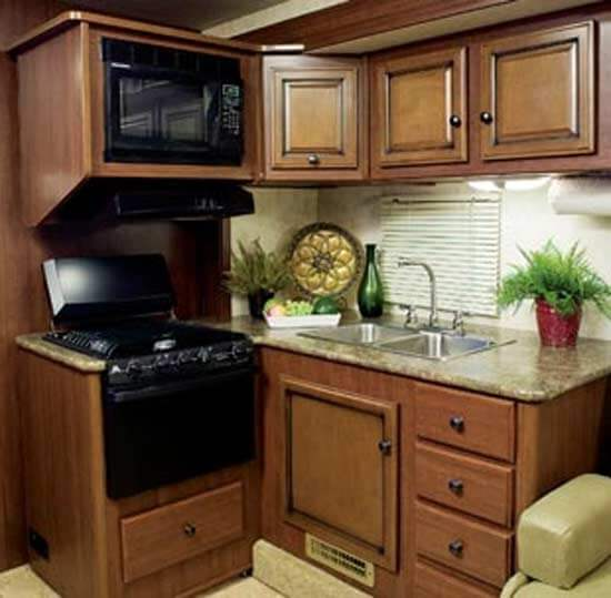 """""""The Galley includes everything you need to prepare a family feast: a big refrigerator, three-burner stove, oven, microwave, large stainless steel sink, and high-rise faucet"""""""