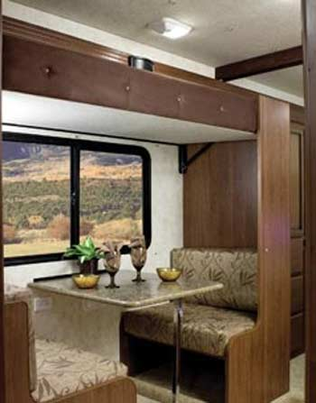 """""""The Bunk-Bed-N-Breakfast a comfy breakfast nook in the morning with a large window to watch the sunrise. Convert to cozy bunk beds at night to dream about tomorrow's adventures."""""""